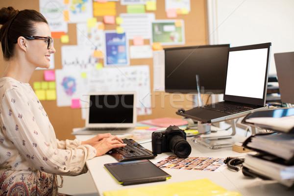 Smiling designer typing on computer keyboard Stock photo © wavebreak_media