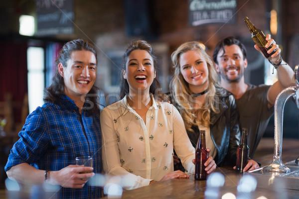 Portré boldog barátok áll bár pult Stock fotó © wavebreak_media