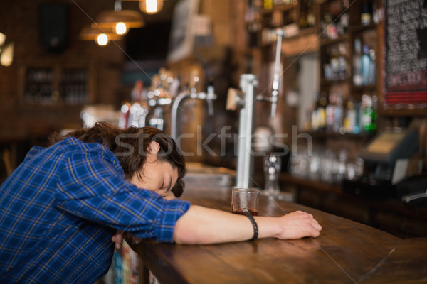 Man leaning on counter in pub Stock photo © wavebreak_media