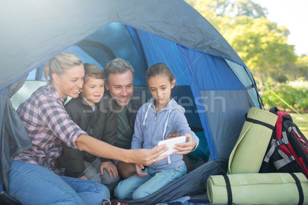 Family taking a selfie in the tent at campsite Stock photo © wavebreak_media