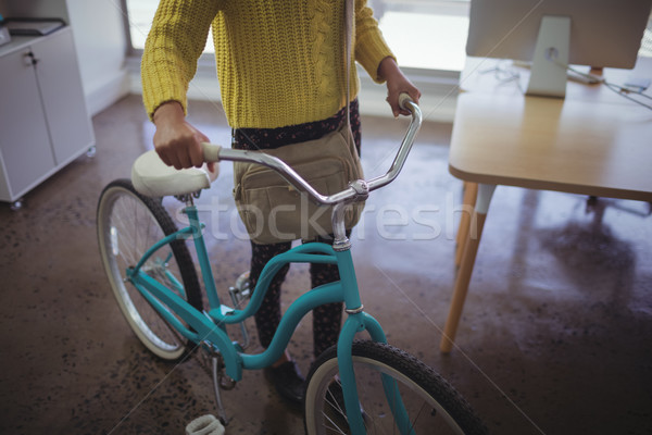 Low section of businesswoman with bicycle office Stock photo © wavebreak_media