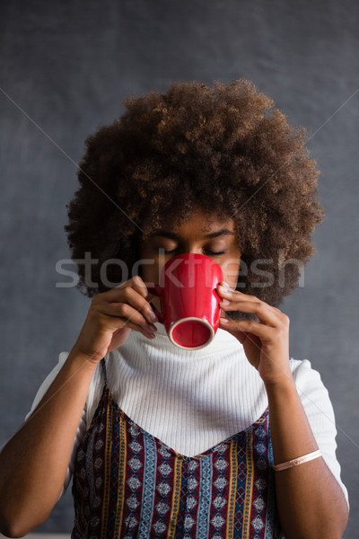 Woman with frizzy hair drinking coffee Stock photo © wavebreak_media