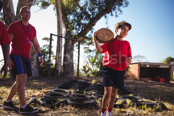 Trainer instructing a boy during obstacle course training Stock photo © wavebreak_media