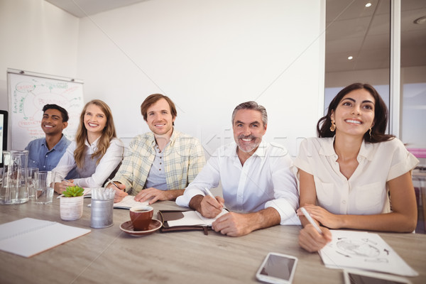 Business executives noting during presentation in office Stock photo © wavebreak_media