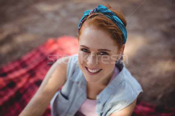 Smiling young woman sitting on mat at olive farm Stock photo © wavebreak_media