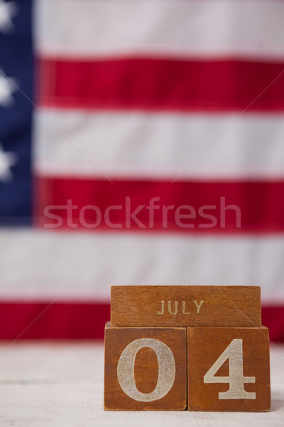 Date blocks arranged against American flag background Stock photo © wavebreak_media