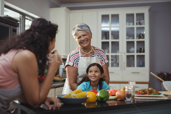 Smiling family interacting with each other in kitchen Stock photo © wavebreak_media