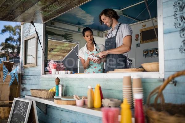 Cameriere cameriera altro counter business donna Foto d'archivio © wavebreak_media