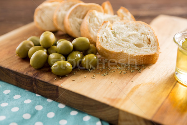 Olive oil with olive and bread kept on chopping board Stock photo © wavebreak_media