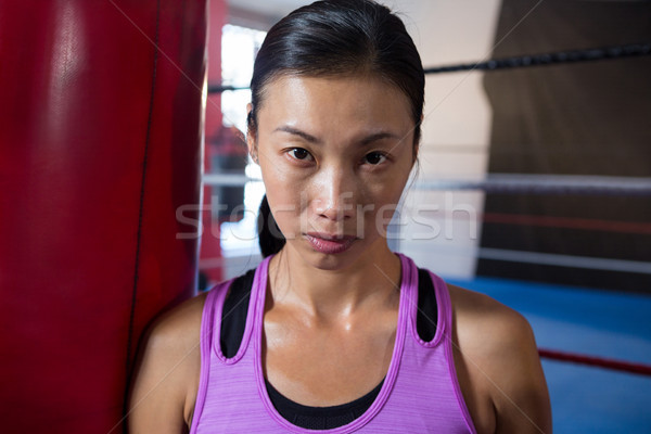 Close-up portrait of confident young female athlete against boxing ring Stock photo © wavebreak_media