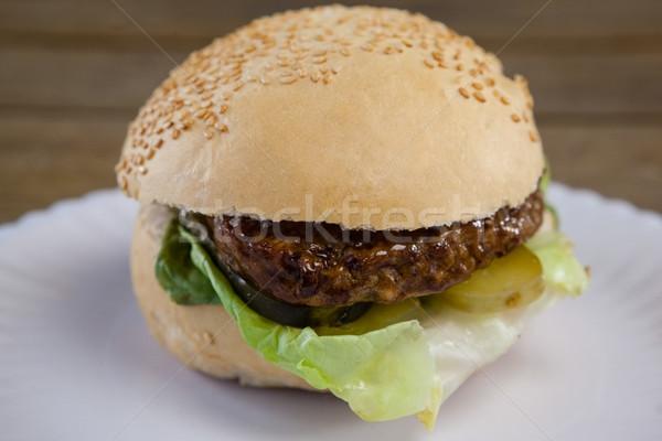 Hamburger in plate on wooden table Stock photo © wavebreak_media