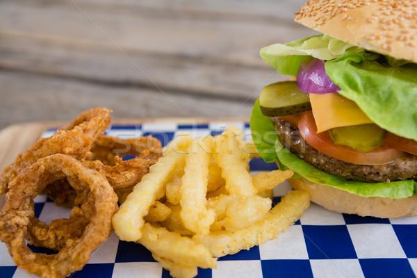 Burger cebolla anillos tabla de cortar Foto stock © wavebreak_media