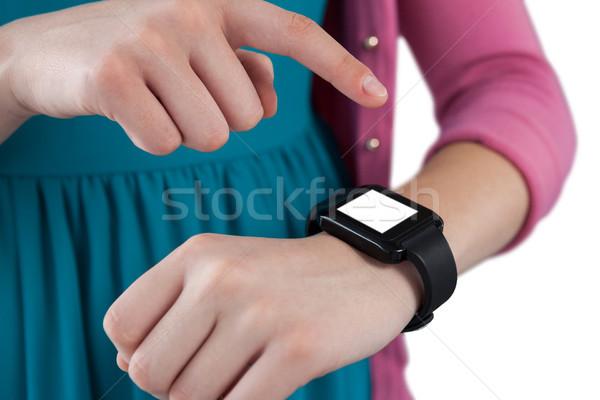 Teenage girl using smartwatch Stock photo © wavebreak_media
