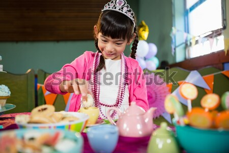 Portrait of cute girls having tea during birthday party Stock photo © wavebreak_media