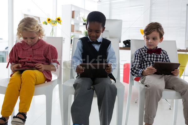 Uomini d'affari tablet computer seduta sedia ufficio Foto d'archivio © wavebreak_media