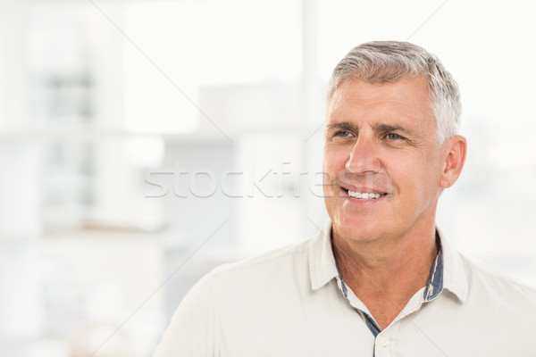 Smiling businessman looking away in the office Stock photo © wavebreak_media