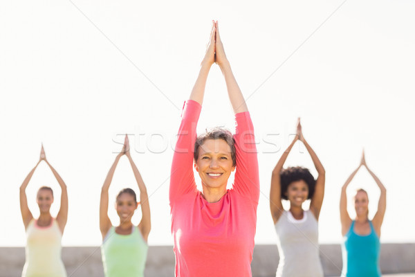 Smiling sporty woman doing yoga in yoga class Stock photo © wavebreak_media