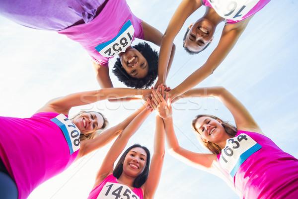 Pięć uśmiechnięty rak piersi maraton portret Zdjęcia stock © wavebreak_media