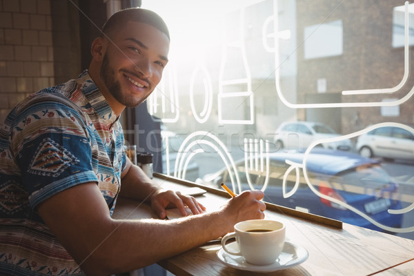 Portrait of man with coffee at window sill in cafe Stock photo © wavebreak_media