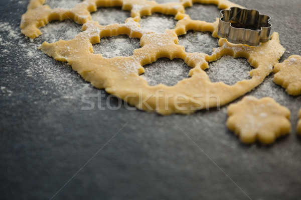High angle view of flower shape pastry cutter on dough Stock photo © wavebreak_media