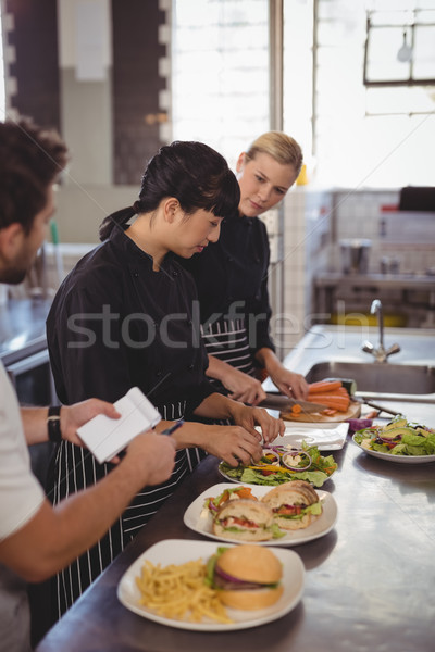Young female chefs preparing food on kitchen counter Stock photo © wavebreak_media
