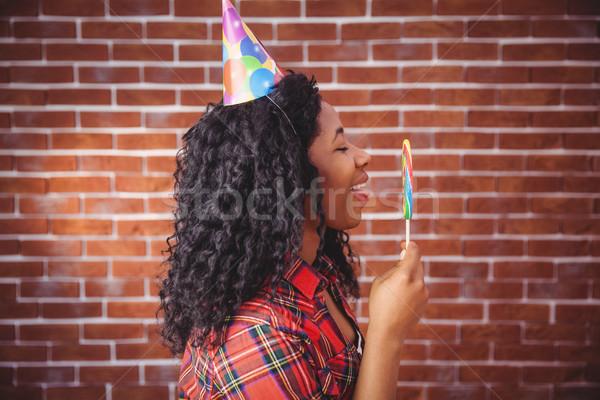 Cute model with hat and lollipop Stock photo © wavebreak_media