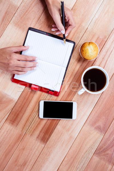 Nőies kezek ír terv kávé okostelefon Stock fotó © wavebreak_media