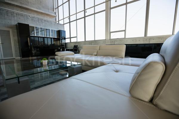 Glass table by empty white sofa at office Stock photo © wavebreak_media