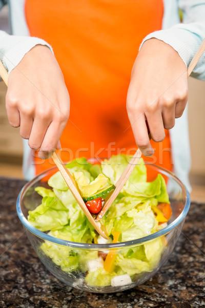 Mid section of woman preparing salad Stock photo © wavebreak_media