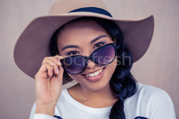 Smiling Asian woman with hat and sunglasses Stock photo © wavebreak_media