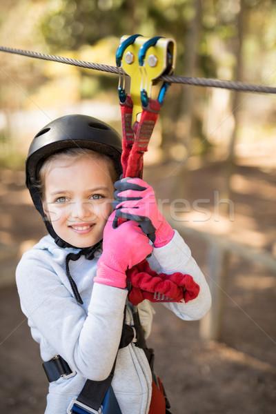 Cute girl enjoying zip line adventure on sunny day Stock photo © wavebreak_media
