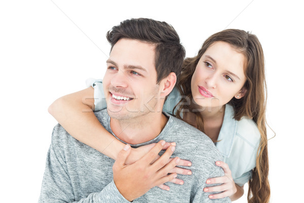 Couple embracing with arms around and looking away Stock photo © wavebreak_media