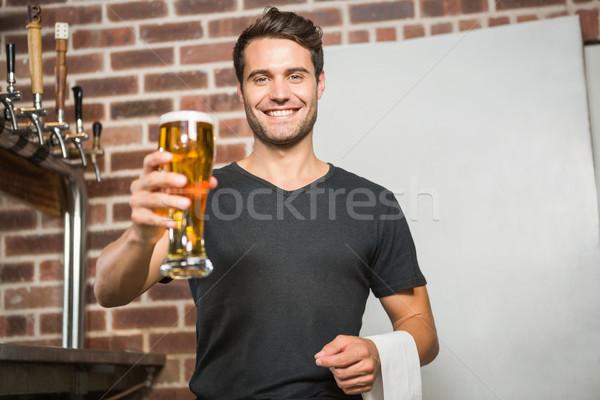 Jóképű férfi tart pint sör kocsma üveg Stock fotó © wavebreak_media