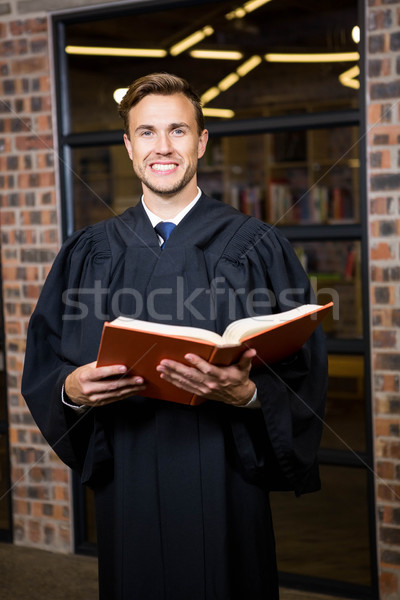 Lawyer standing near library with law book Stock photo © wavebreak_media