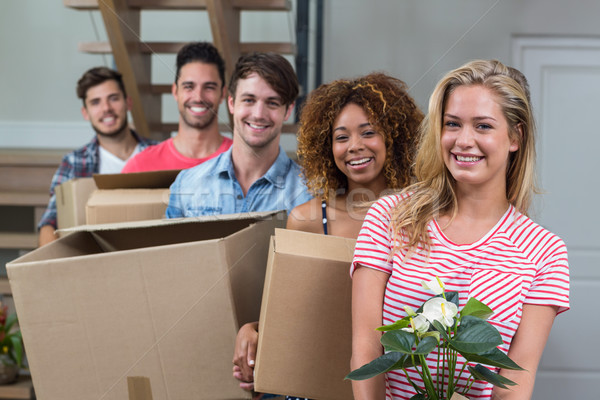 Friends smiling while carrying boxes in new house Stock photo © wavebreak_media