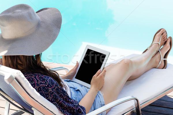 Woman using her tablet  Stock photo © wavebreak_media
