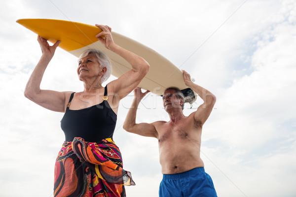 Starszy para deska surfingowa głowie plaży kobieta Zdjęcia stock © wavebreak_media