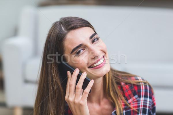 Gyönyörű nő beszél telefon portré otthon nő Stock fotó © wavebreak_media