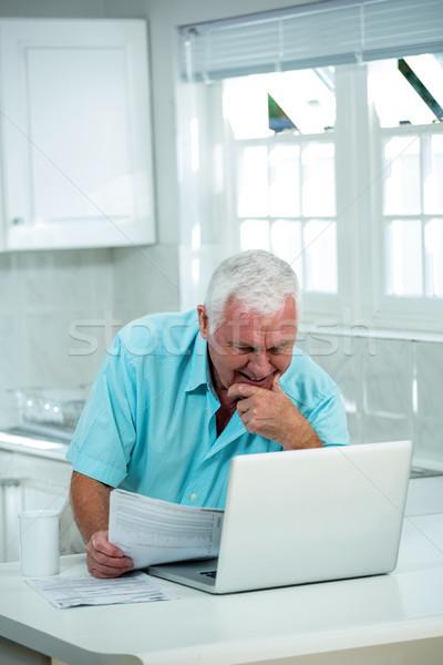 Smiling man looking into laptop Stock photo © wavebreak_media
