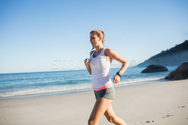 Fit woman on the beach  Stock photo © wavebreak_media