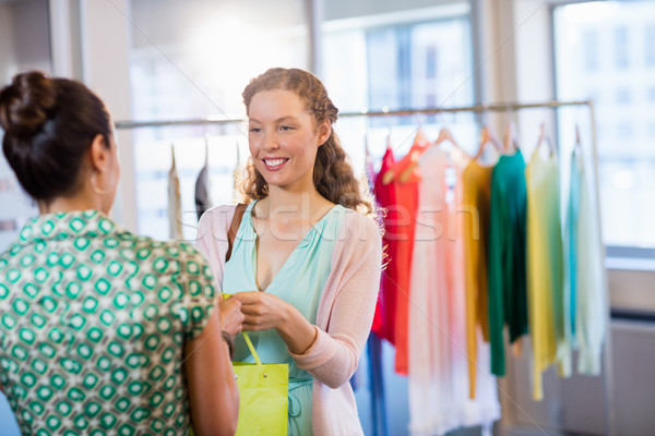 Females friends with shopping bags Stock photo © wavebreak_media