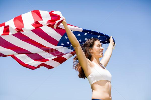 Kadın atlet amerikan bayrağı hava zafer Stok fotoğraf © wavebreak_media