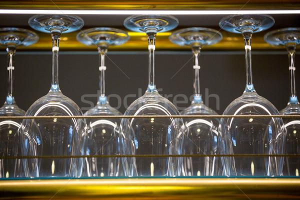 Wine glass arranged in bar rack Stock photo © wavebreak_media