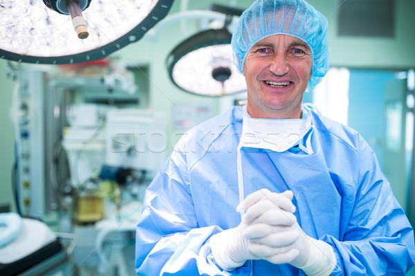 Portret glimlachend chirurgen permanente operatie kamer Stockfoto © wavebreak_media