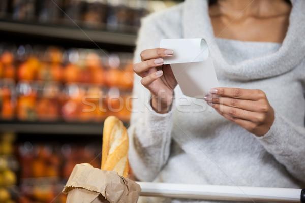 Mid section of woman holding bill Stock photo © wavebreak_media