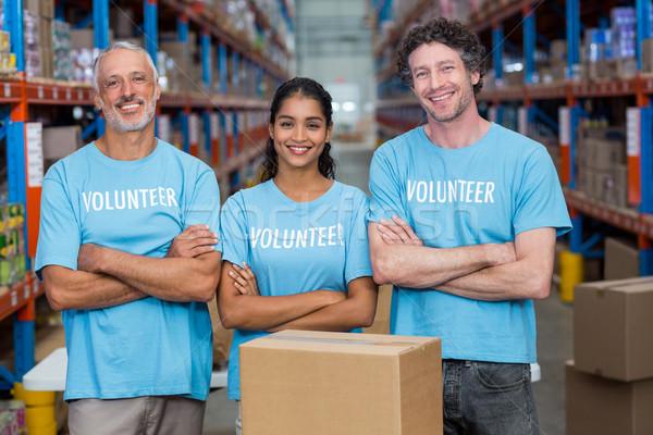 Portré három boldog önkéntesek áll keresztbe tett kar Stock fotó © wavebreak_media