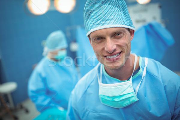 Portrait of male surgeon smiling in operation theater Stock photo © wavebreak_media