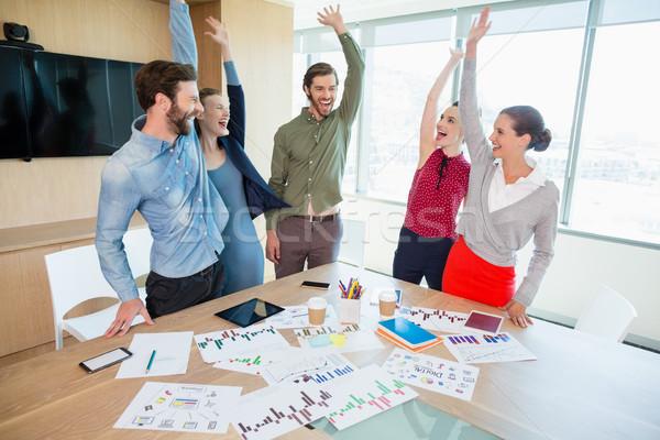 Sorridente negócio executivo sala de conferência escritório Foto stock © wavebreak_media
