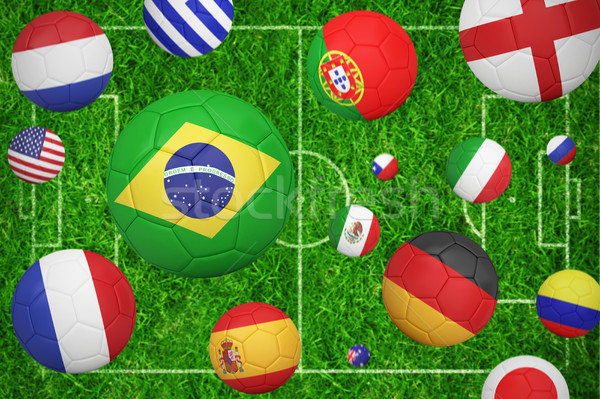 Footballs in various flag colours  against closed up view of grass Stock photo © wavebreak_media