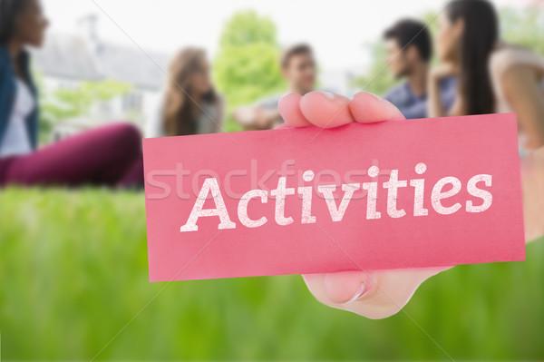 Faaliyetler mutlu Öğrenciler oturma dışında kampus Stok fotoğraf © wavebreak_media